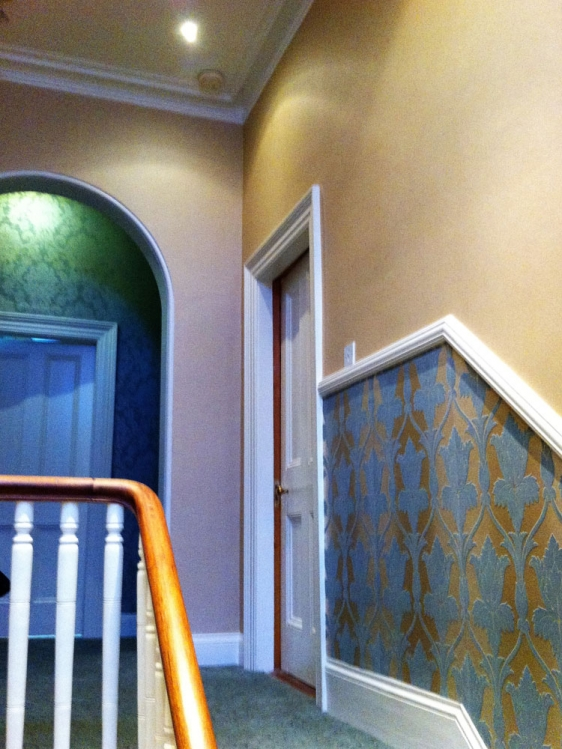Wallpapering throughout, woodwork, cornices and friezes.